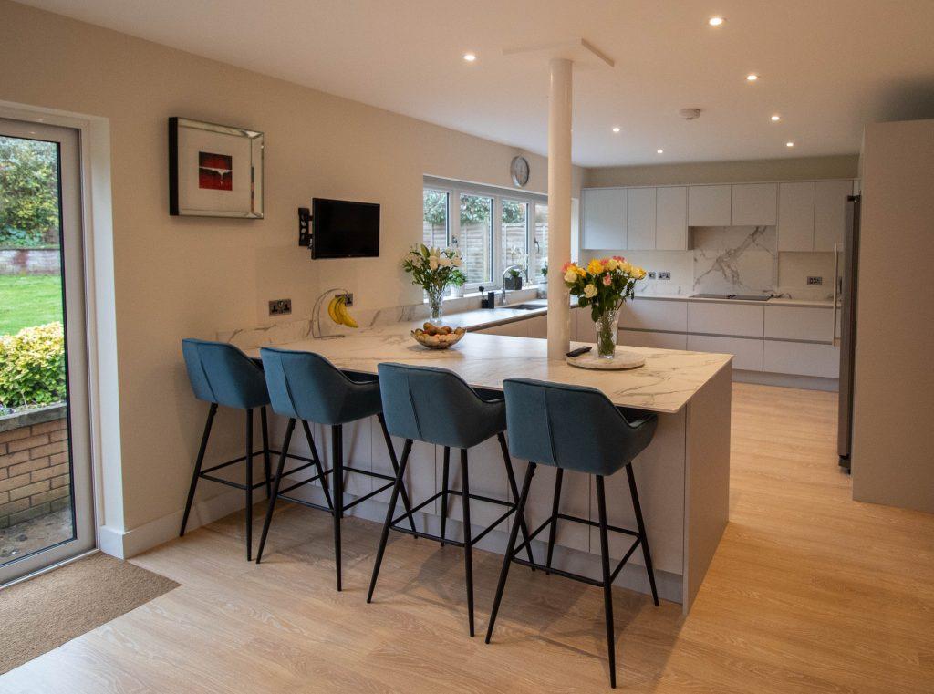 Light grey handle-less kitchen, Noble Kitchens
